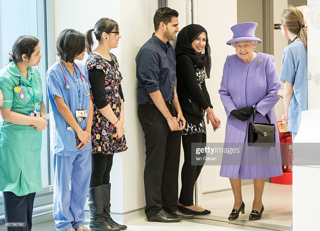 Queen Elizabeth II meets staff during her tour to open the new Royal London Hospital building and the new National Centre for Bowel Research and Surgical Innovation on February 27, 2013 in London, England.