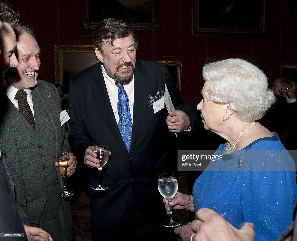 Queen Elizabeth II meets Steven Fry during the Dramatic Arts reception at Buckingham Palace on February 17, 2014 in London, England.