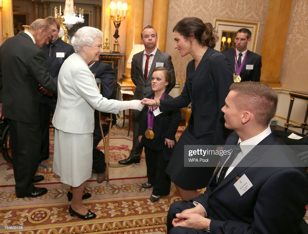 Queen Elizabeth II meets swimmer Ellie Simmonds and cyclist Sarah Storey during a reception for the Team GB Olympic and Paralympic medalists at Buckingham Palace on October 23, 2012 in London, England.