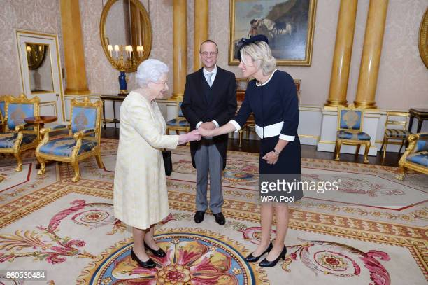 Queen Elizabeth II meets the Ambassador of Belgium Mr Rudolf Huygelen accompanied by Mrs Marianne Lecleu during a private audience at Buckingham...