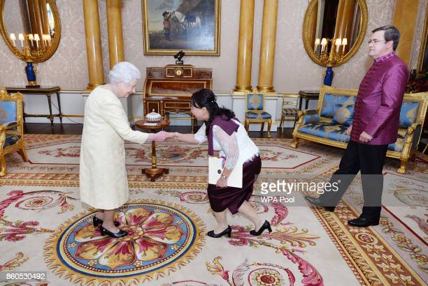 Queen Elizabeth II meets the Ambassador of Cambodia Dr Soeung Rathchavy accompanied by Mr Vladimir Maximov during a private audience at Buckingham...