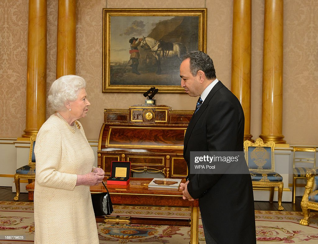 Queen <a gi-track='captionPersonalityLinkClicked' href=/galleries/search?phrase=Elizabeth+II&family=editorial&specificpeople=67226 ng-click='$event.stopPropagation()'>Elizabeth II</a> meets the Ambassador of Egypt Mohamed Ashraf El Kholy during an audience at Buckingham Palace, on May 15, 2013 in central London, England.