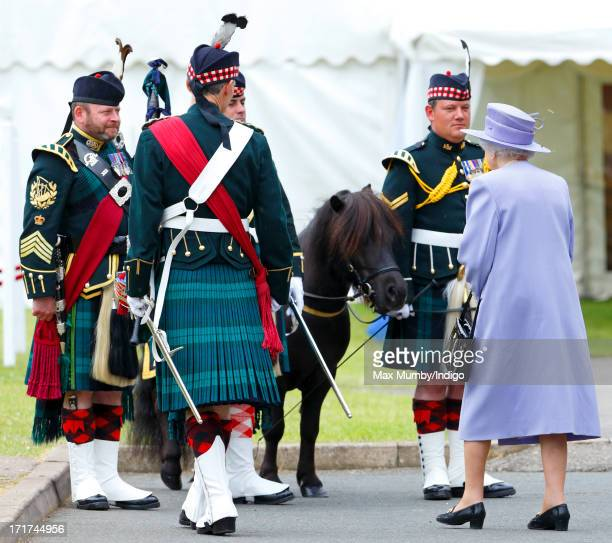 Queen Elizabeth II meets the Argyll Sutherland Highlanders regimental Shetland pony mascot during a visit to the Argyll Sutherland Highlanders 5th...
