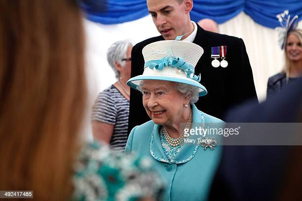 Queen Elizabeth II meets the company of HMS Lancaster and their families as she visits Portsmouth Naval Base for a visit to the the ship on May 20...