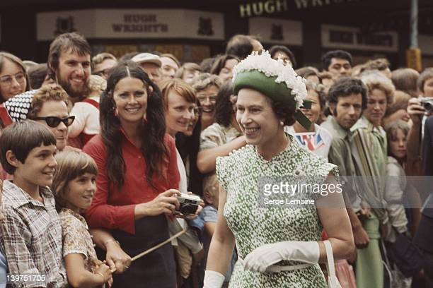 Queen Elizabeth II meets the crowd during her visit to New Zealand 1977