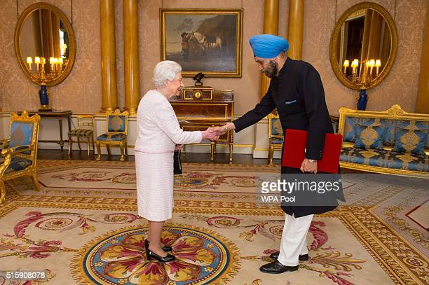 Queen Elizabeth II meets the High Commissioner for India Navtej Sarna during an audience on March 16 2016 at Buckingham Palace London