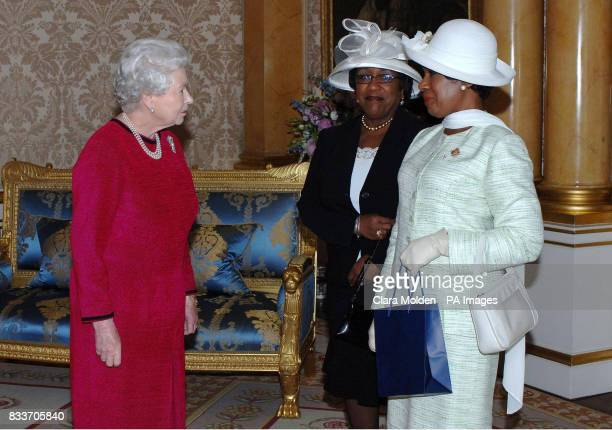 Queen Elizabeth II meets the Lieutenant Governor of Nova Scotia Ms Mayann Francis and her sister Ms Isabel Waterman inside Buckingham Palace central...