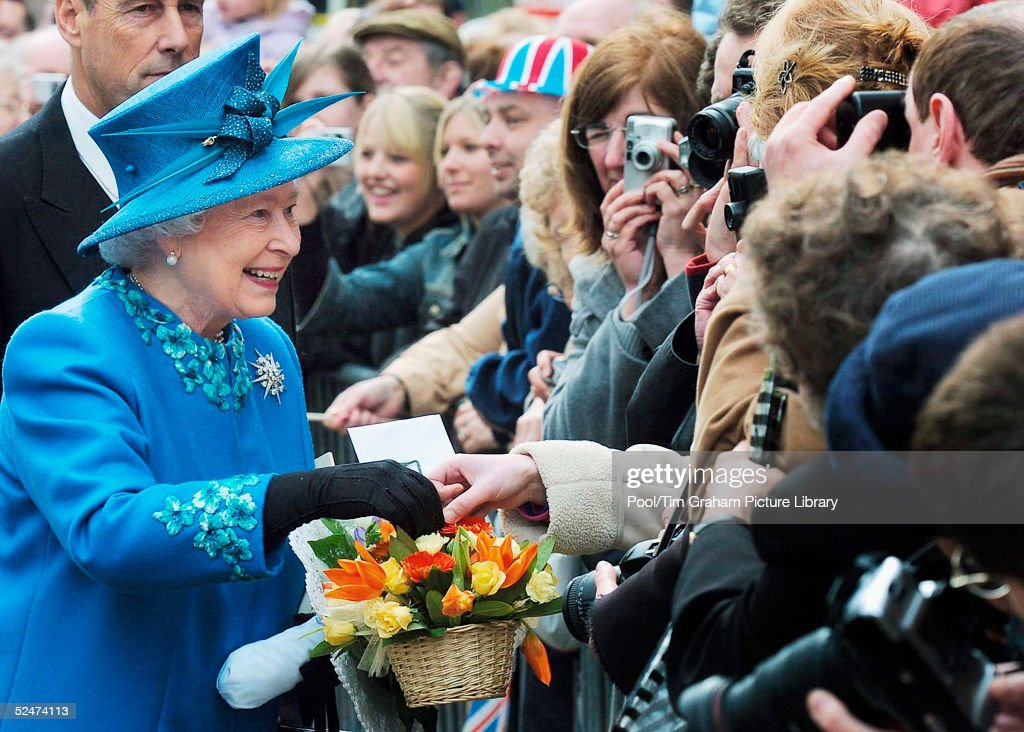 Queen Elizabeth II meets the public and receives gifts of flowers during a walkabout after the traditional Maundy Service on March 24, 2005 in Wakefield, England.