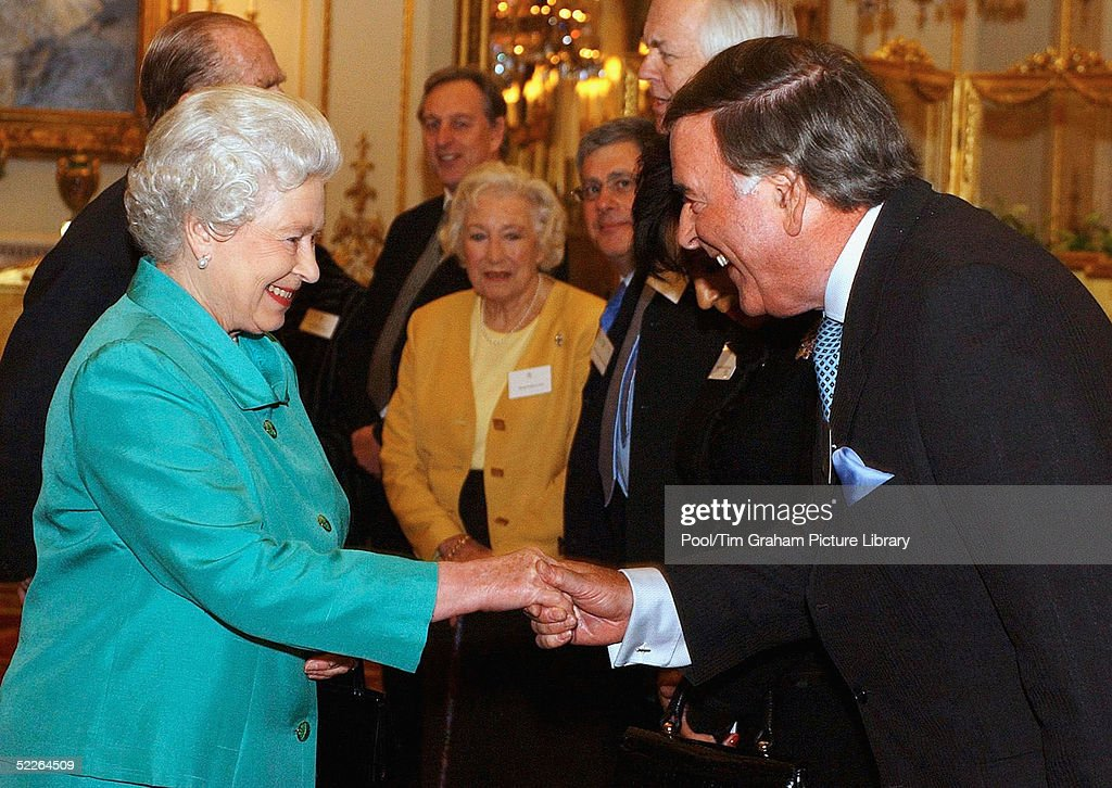 Queen <a gi-track='captionPersonalityLinkClicked' href=/galleries/search?phrase=Elizabeth+II&family=editorial&specificpeople=67226 ng-click='$event.stopPropagation()'>Elizabeth II</a> meets TV and Radio Broadcaster <a gi-track='captionPersonalityLinkClicked' href=/galleries/search?phrase=Terry+Wogan&family=editorial&specificpeople=234787 ng-click='$event.stopPropagation()'>Terry Wogan</a> at the 'Music Day At The Palace' event at Buckingham Palace on March 1, 2005 in London, England. The Royal reception was held to recognise the excellence of British music and the contribution it makes to the culture and economy of the UK.