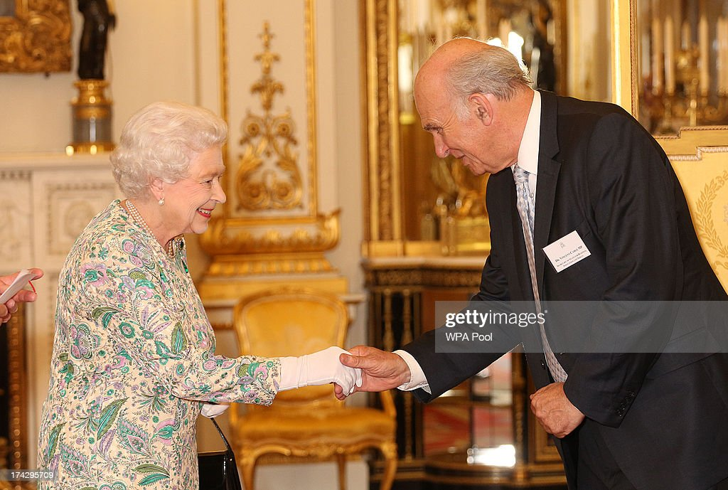 Queen Elizabeth II meets Vince Cable the Secretary of State for Business, Innovation and Skills at a reception for the Winners of the Queens Award for Enterprise 2013 at Buckingham Palace in London. Tuesday July 23, 2013.