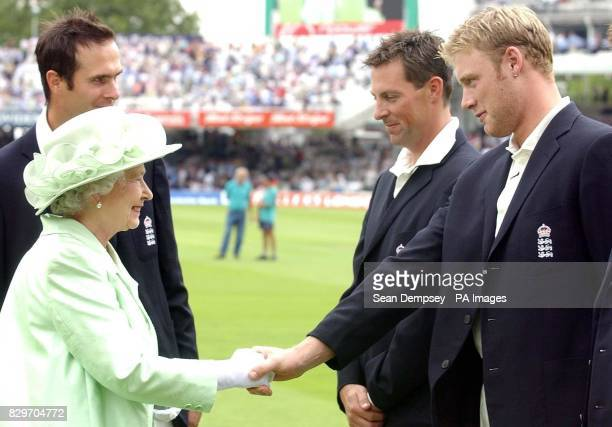 Queen Elizabeth II meets with England's Andrew Flintoff as Marcus Trescothick and Michael Vaughan look on during the first day of the npower Test...