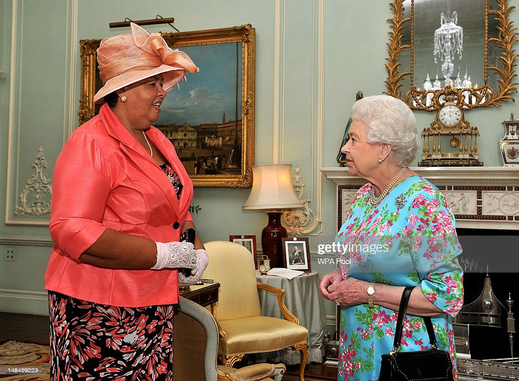 Queen <a gi-track='captionPersonalityLinkClicked' href=/galleries/search?phrase=Elizabeth+II&family=editorial&specificpeople=67226 ng-click='$event.stopPropagation()'>Elizabeth II</a> (R) meets with Mrs Aloun Ndombet-Assamba, the High Commissioner for Jamaica, during a private audience at Buckingham Palace on July 17, 2012 in central London, England.