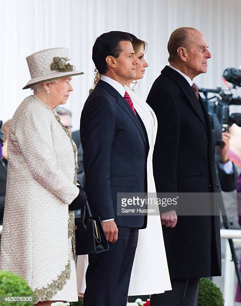 Queen Elizabeth II Mexican President Enrique Pena Nieto Angelica Rivera and Prince Philip Duke of Edinburgh attend a ceremonial welcome for The...