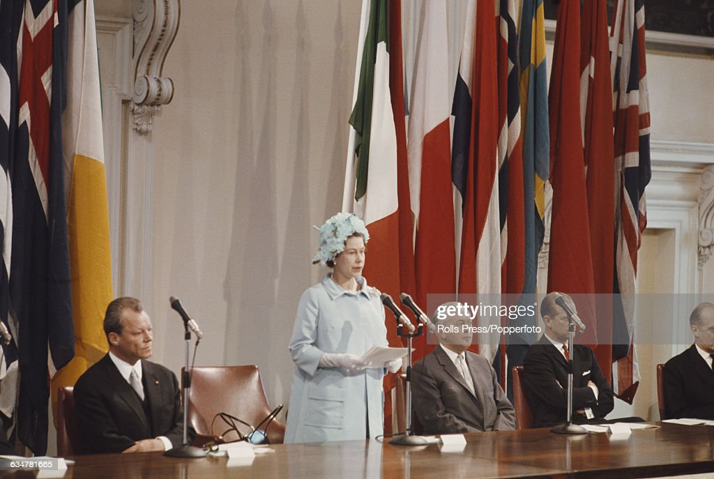 Queen Elizabeth II of the United Kingdom addresses a 20th anniversary meeting of the Council of Europe from a dias inside the Banqueting House in Whitehall, London on 5th May 1969. Other dignitaries on the rostrum are, from left to right, German Minister of Foreign Affairs Willy Brandt, Prime Minister Harold Wilson and Prince Philip, Duke of Edinbugh.