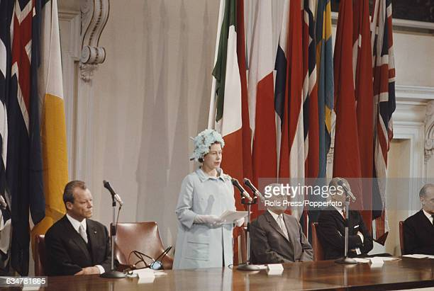 Queen Elizabeth II of the United Kingdom addresses a 20th anniversary meeting of the Council of Europe from a dias inside the Banqueting House in...