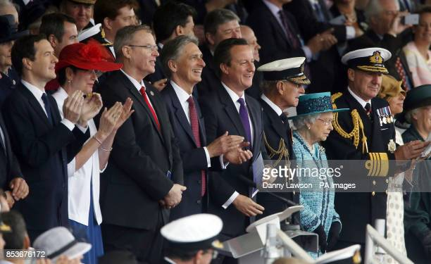 Queen Elizabeth II officially names Royal Navy's new aircraft carrier HMS Queen Elizabeth with Prime Minister David Cameron Defence Secretary Philip...
