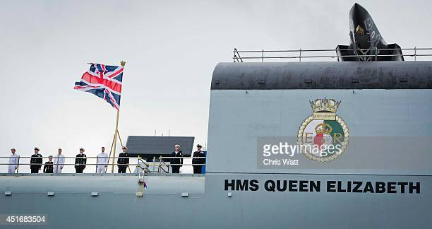 Queen Elizabeth II officially names the Royal Navy's new aircraft carrier HMS Queen Elizabeth on July 4 2014 in Rosyth Scotland HMS Queen Elizabeth...