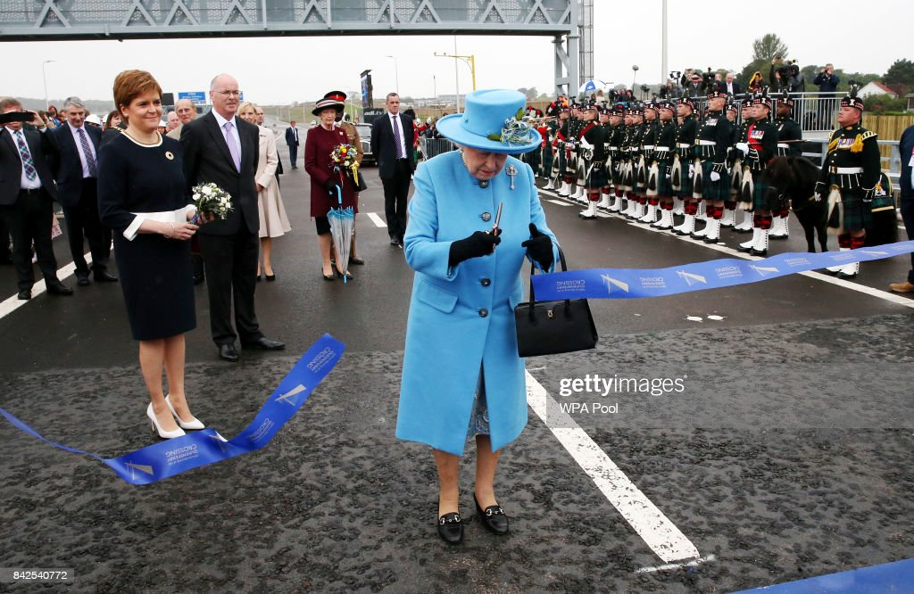 Queen Elizabeth II officially opens the Queensferry Crossing as Prince Philip, Duke of Edinburgh and First Minister Nicola Sturgeon look on during the official opening ceremony of the Queensferry Crossing, on September 4, 2017 in South Queensferry, Scotland. Scotland's newest road bridge which began construction in 2011, crosses the Firth of Forth near Edinburgh. The crossing is the world's longest three tower cable stayed bridge.