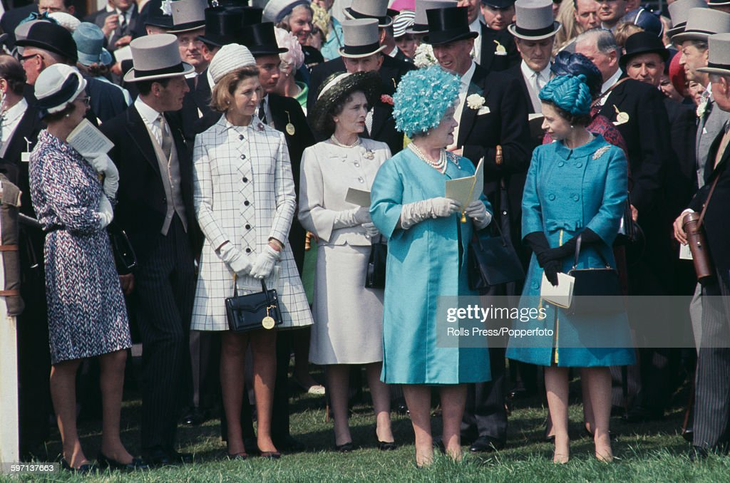 Queen <a gi-track='captionPersonalityLinkClicked' href=/galleries/search?phrase=Elizabeth+II&family=editorial&specificpeople=67226 ng-click='$event.stopPropagation()'>Elizabeth II</a>, on far right wearing a light blue coat and hat talks with her mother Queen Elizabeth The Queen Mother, wearing a turquoise summer coat and matching hat at the Epsom Derby race meeting at Epsom Downs Racecourse in Surrey, England in June 1968. Princess Alexandra, The Honourable Lady Ogilvy stands 3rd from left wearing a white checked coat and white hat with her husband <a gi-track='captionPersonalityLinkClicked' href=/galleries/search?phrase=Angus+Ogilvy&family=editorial&specificpeople=160704 ng-click='$event.stopPropagation()'>Angus Ogilvy</a>, 2nd from left.