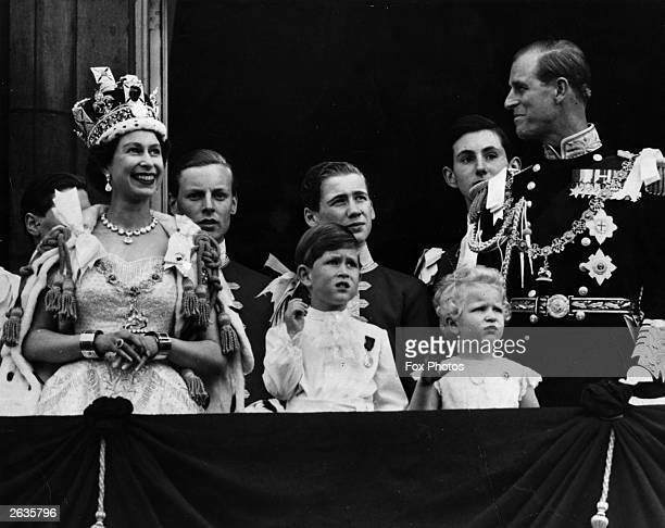 Queen Elizabeth II on the balcony of Buckingham Palace after her Coronation ceremony with Prince Charles Princess Anne and The Prince Philip Duke of...