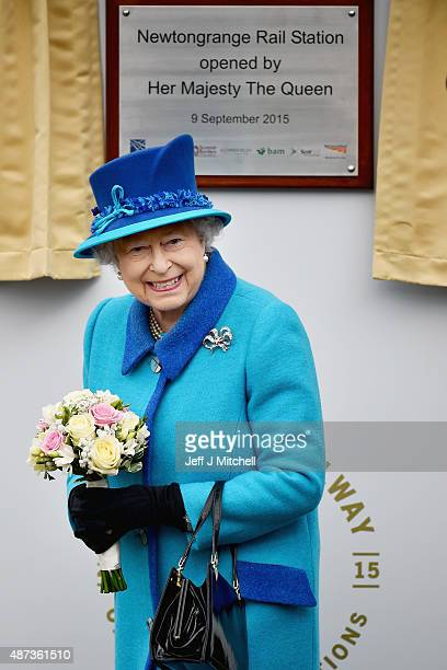 Queen Elizabeth II opens Newtongrange Station after arriving on the steam locomotive the 'Union of South Africa' on September 9 2015 in Newtongrange...
