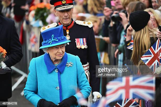 Queen Elizabeth II opens Newtongrange Station after arriving on the steam locomotive the Union of South Africa on September 9 2015 in Newtongrange...