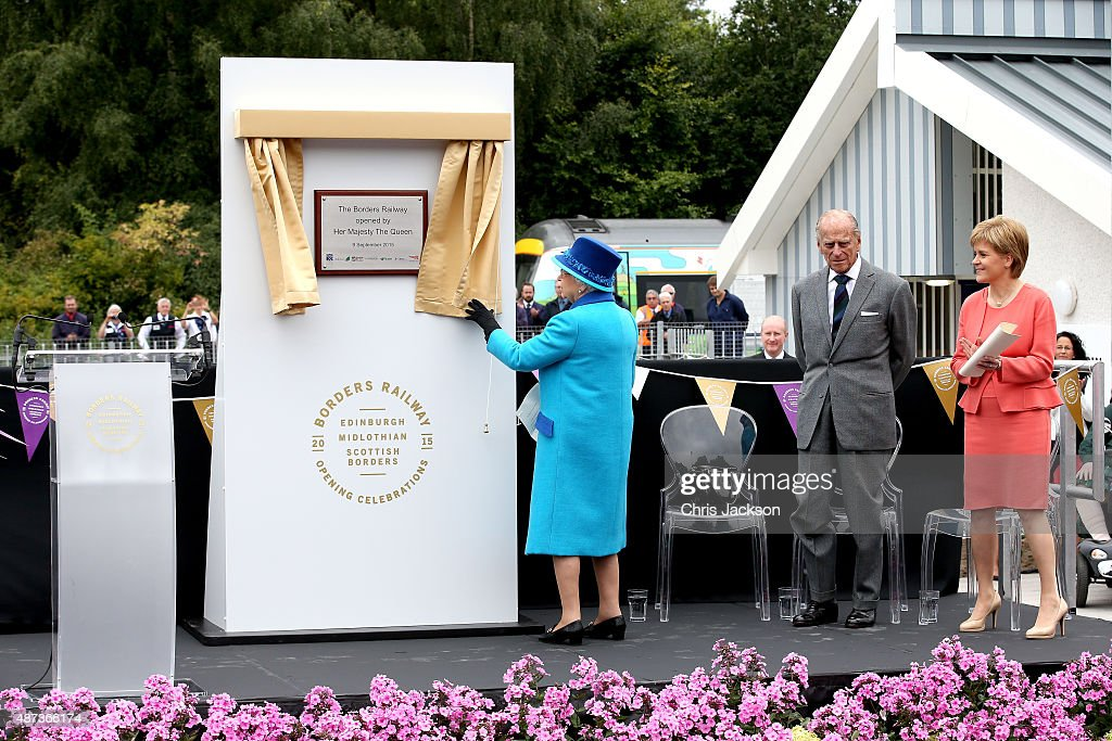 Queen Elizabeth II opens the Borders Railway as First Minister of Scotland Nicola Sturgeon and Prince Philip, Duke of Edinburgh looks on atTweedbank Station on September 9, 2015 in Tweedbank, Scotland. Today, Her Majesty Queen Elizabeth II becomes the longest reigning monarch in British history overtaking her great-great grandmother Queen Victoria's record by one day. The Queen has reigned for a total of 63 years and 217 days. Accompanied by her husband, the Duke of Edinburgh and Scotland's First Minister Nicola Sturgeon, she will officially open the new Scottish Border's Railway which runs from the capital to Tweedbank.