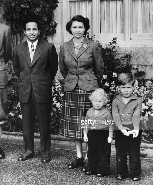Queen Elizabeth II outside Balmoral Castle with her Royal visitor King Faisal II of Iraq and Princess Anne and Prince Charles