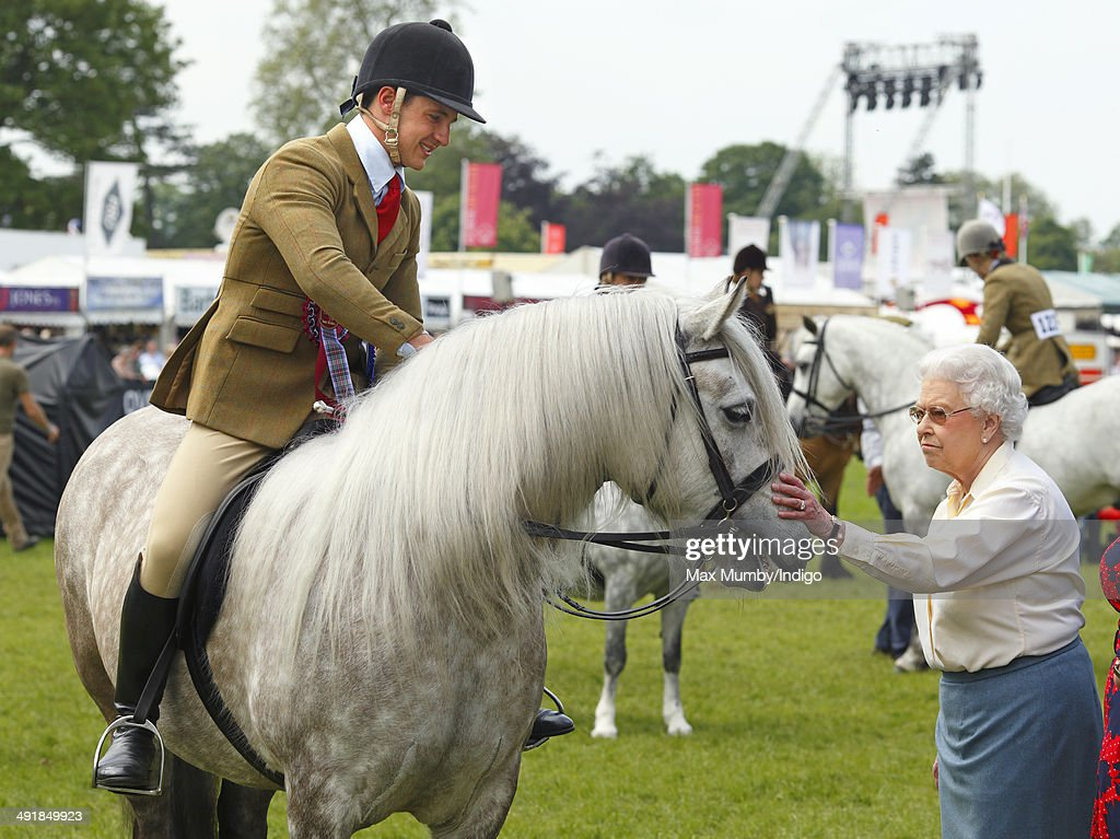 Queen Elizabeth II pats her horse 'Balmoral Erica' after it came second in the Ridden Mountain and Moorland Class on day 4 of the Royal Windsor Horse Show at Home Park on May 17, 2014 in Windsor, England.