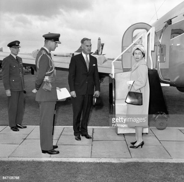 Queen Elizabeth II pauses for a moment before boarding a Heron aircraft of the Queen's Flight when leaving Heathrow Airport for South Cerny...