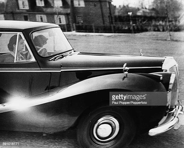 Queen Elizabeth II pictured at the wheel and driving a Daimler car in Windsor England April 16th 1953