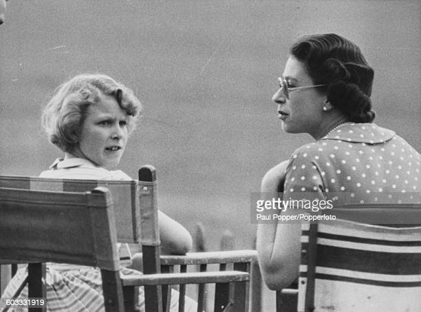 Queen Elizabeth II pictured with her daughter Princess Anne as they watch Prince Philip play polo at Smith's Lawn in Windsor Great Park England on...