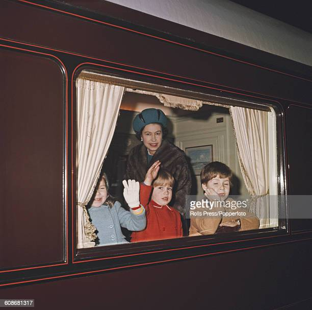Queen Elizabeth II pictured with Prince Andrew and Prince Edward in a compartment of the Royal Train before departure from London in December 1965