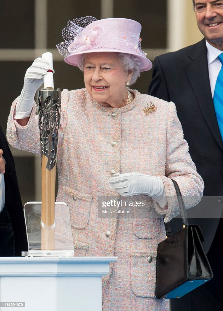 Queen <a gi-track='captionPersonalityLinkClicked' href=/galleries/search?phrase=Elizabeth+II&family=editorial&specificpeople=67226 ng-click='$event.stopPropagation()'>Elizabeth II</a> places a message inside the Baton at the launch of The Baton Relay for the 2014 Commonwealth Games at Buckingham Palace on October 9, 2013 in London, England.