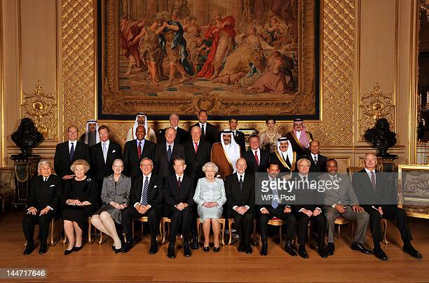 Queen Elizabeth II poses for group photo with her Royal guests Emperor Akihito of Japan Queen Beatrix of The Netherlands Queen Margrethe II of...