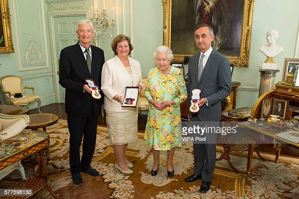 Queen Elizabeth II poses with Sir James Dyson Professor Dame Ann Dowling and Lord Darzi of Denham after presenting them with the insignia of members...