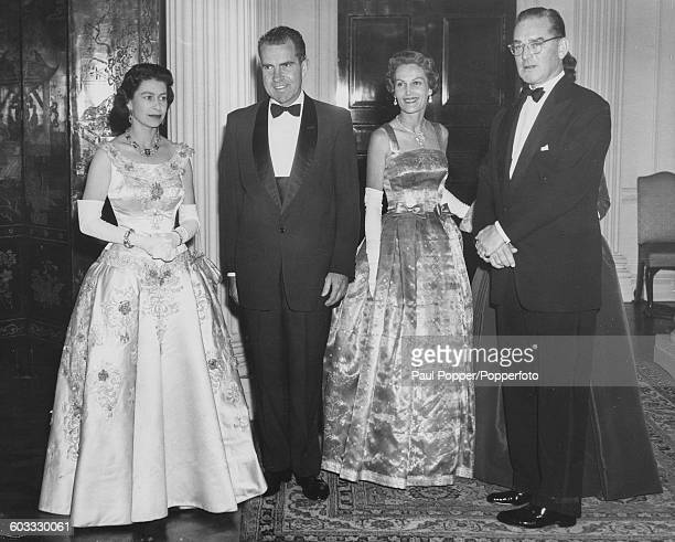 Queen Elizabeth II poses with United States VicePresident Richard Nixon Pat Nixon and United States Ambassador John Hay Whitney as they attend a...