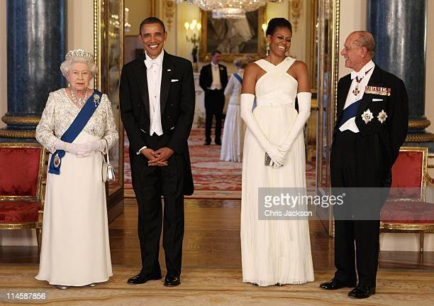 Queen Elizabeth II poses with US President Barack Obama his wife Michelle Obama and Prince Philip Duke of Edinburgh in the Music Room of Buckingham...