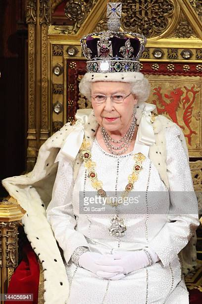 Queen Elizabeth II prepares to deliver her speech in the House of Lords during the State Opening of Parliament on May 9 2012 in London England Queen...