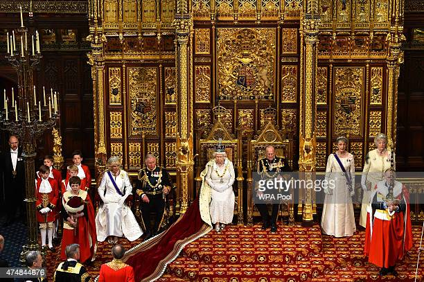 Queen Elizabeth II prepares to give the Queen's Speech from the throne in the House of Lords next to Prince Philip Duke of Edinburgh and Prince...