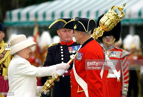 Queen Elizabeth II Presenting A New Mace To The Chelsea Pensioners The Corps Of War Veterans Cared For At The Royal Hospital In Chelsea And Known For...