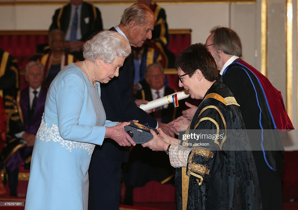 Queen Elizabeth II presents a Queen's Anniversary Prize for Higher and Further Education Award to Dame Julia Goodfellow from University of Kent on February 27, 2014 in London, England.