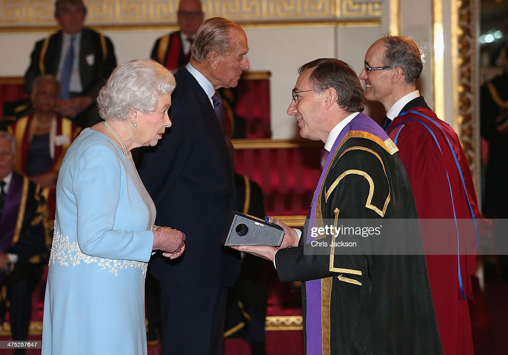 Queen Elizabeth II presents a Queen's Anniversary Prize for Higher and Further Education Award to Michael Arthur of University College London on February 27, 2014 in London, England.