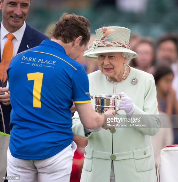 Queen Elizabeth II presents awards during the Bentley Motors Royal Windsor Cup Final at Guards Polo Club Windsor Great Park Egham Berkshire