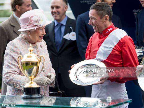 Queen Elizabeth II presents Frankie Dettori with the winners prize for the Queen Elizabeth ll Stakes at The Qipco British Champions Day at Ascot...
