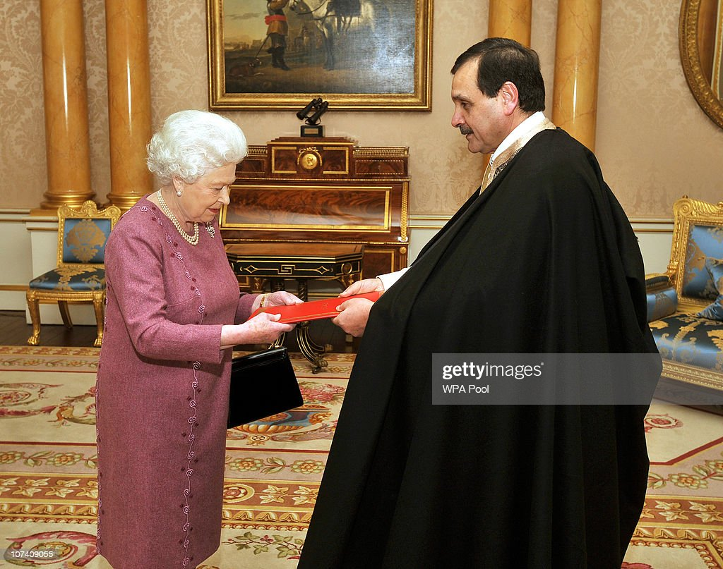 Queen <a gi-track='captionPersonalityLinkClicked' href=/galleries/search?phrase=Elizabeth+II&family=editorial&specificpeople=67226 ng-click='$event.stopPropagation()'>Elizabeth II</a> presents His Excellency the Ambassador of Tunisia Mr Hatem Atallah with his credentials during a private meeting at Buckingham Palace on December 8, 2010 in London, England.