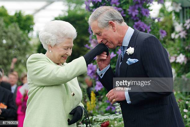 Queen Elizabeth II presents Prince Charles Prince of Wales with the Royal Horticultural Society's Victoria Medal of Honour during a visit to the...