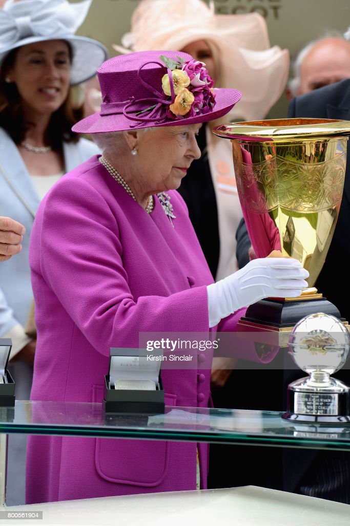 Queen Elizabeth II presents the Diamond Jubilee Stakes Cup after The Tin Man wins, ridden by Tom Queally on day 5 of Royal Ascot 2017 at Ascot Racecourse on June 24, 2017 in Ascot, England.