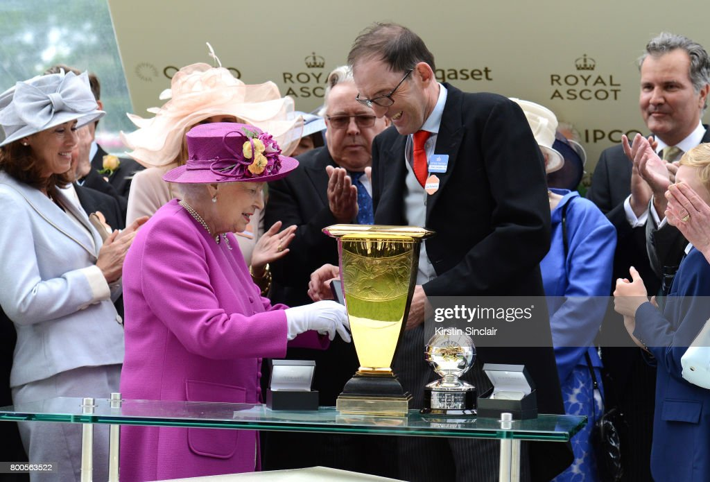 Queen Elizabeth II presents the Diamond Jubilee Stakes Cup to trainer James Fanshawe after The Tin Man wins, ridden by Tom Queally on day 5 of Royal Ascot 2017 at Ascot Racecourse on June 24, 2017 in Ascot, England.