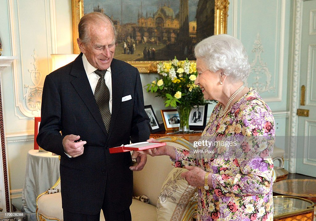Queen <a gi-track='captionPersonalityLinkClicked' href=/galleries/search?phrase=Elizabeth+II&family=editorial&specificpeople=67226 ng-click='$event.stopPropagation()'>Elizabeth II</a> presents the Duke of Edinburgh with New Zealand's highest honour, the Order of New Zealand in the presence of Sir Lockwood Smith, High Commissioner for New Zealand, at Buckingham Palace on June 6, 2013 in London, England.